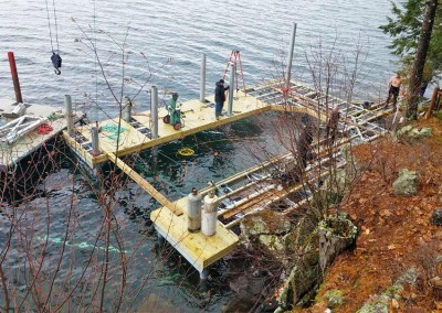 During construction - our pile dock serves as the foundation for this boathouse