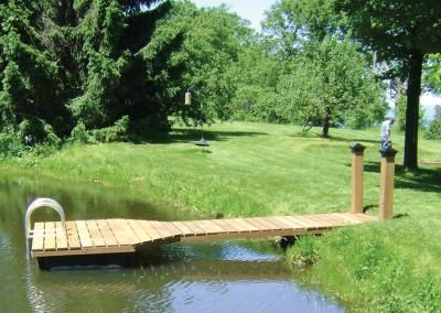 4' x 16' pond dock with cedar skirt boards & custom post covers