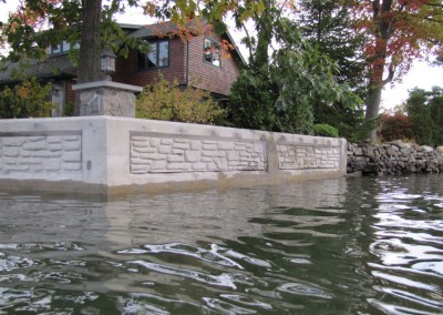 Concrete seawall refacing using decorative form liners