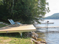 Shoreside platform used as a shore hitch for an articulating dock