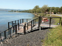 Steel stairs and shoreside platform for a roadside waterfront site