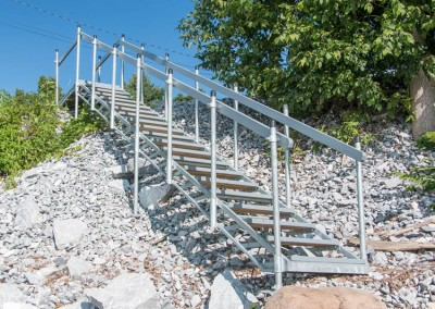 Steel stairs over a rocky shoreline