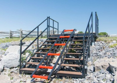 Stairs with built-in roller ramp for small craft transport