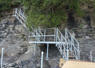 Steel stairs with shoreside platform as a landing