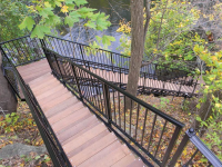 Freespan stairs with black powder coating and Ipe treads - these stairs traverse a vertical drop of 60 feet