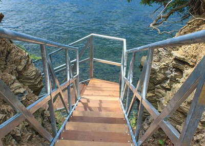 Steel stair system for a difficult to access waterfront site