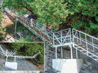 Freespan steel stairs with lower section that hinges for winter storage