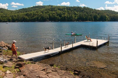 Aluminum floating dock with WearDeck composite decking and a 4' × 12' dock section used as a ramp.