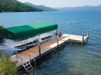 Our heavy duty steel truss leg dock with cedar decking, aluminum vertical boatlift with Sunbrella canopy